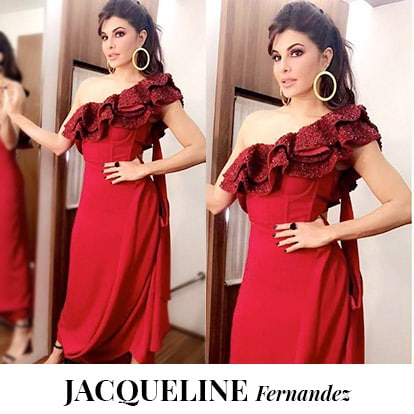 <p>We are completely crushing over Jacqueline's one shoulder red dress with an absolutely gorgeous ruffled neckline which is sure to turn heads wherever you go! Slay it like her with our One-shoulder ruffled midi dress pair and to complete the look add a little bling to your outfit with our Glitter Flap Bag in Oxblood, Oxblood Tortoise shell earrings and Black lace up heels.</p>